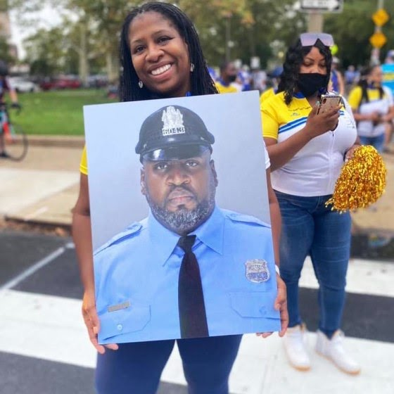 Octavia Tokley lost her husband Erin to Covid-19 in March. He was a 24-year veteran of the Philadelphia Police Department.
